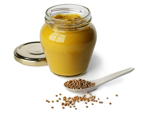 Mustard in a jar and mustard seeds