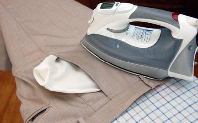 stirare tasche pantaloni